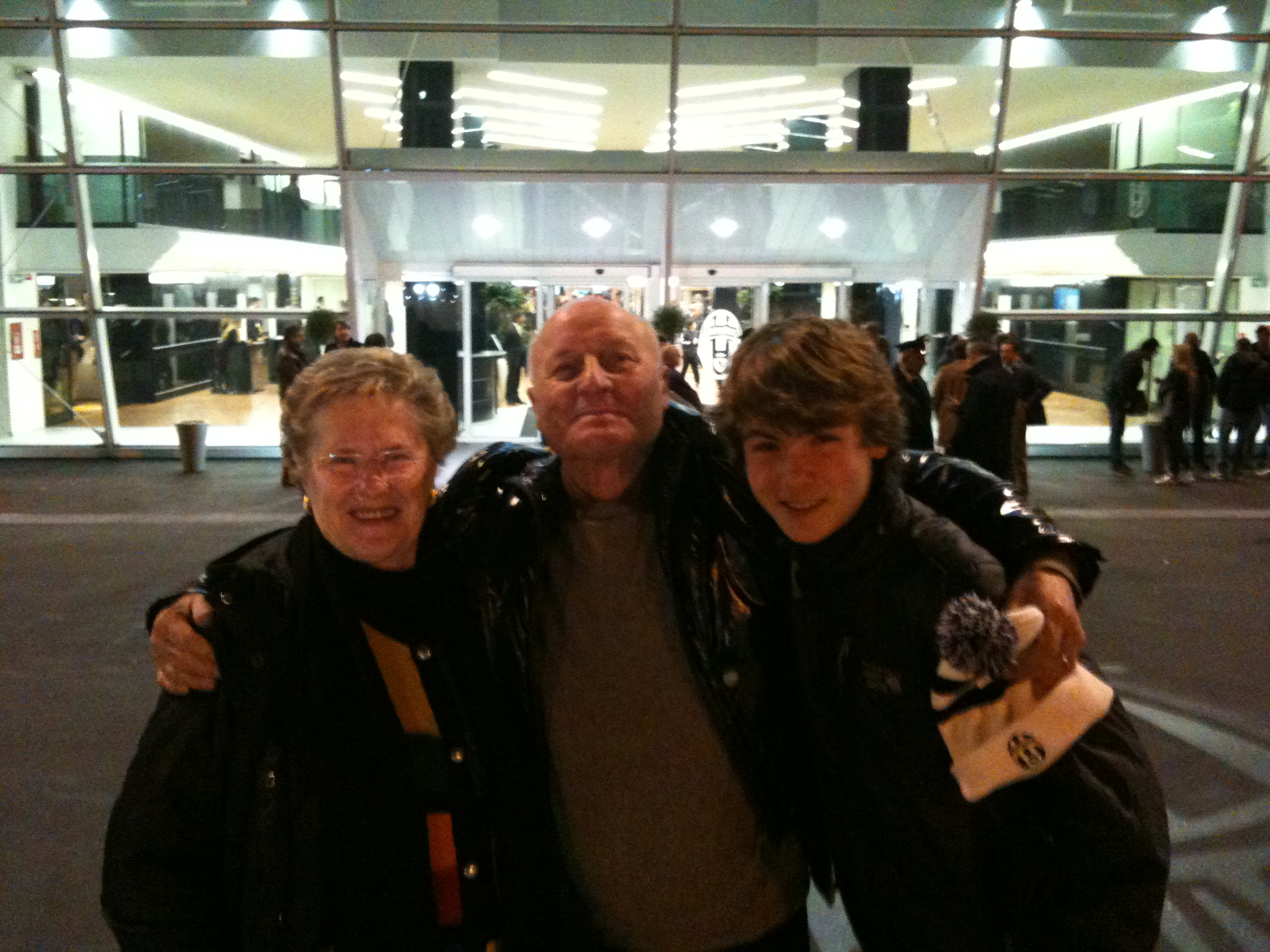 My Nonno Carlo, Nonna Italia, and me in front of the Juventus Stadium (my favorite soccer team).