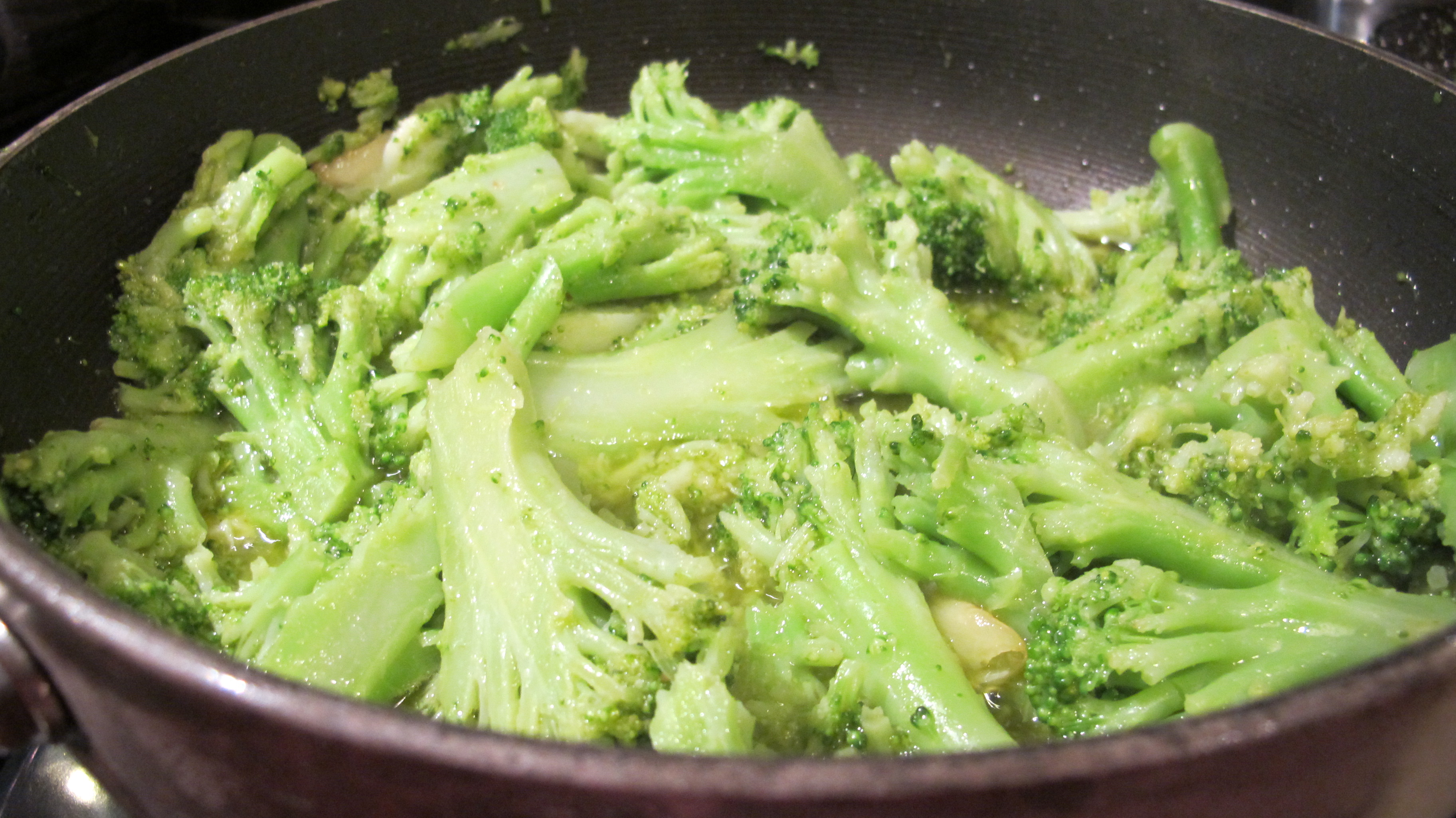 The broccoli is sautéed in with the garlic-olive oil.