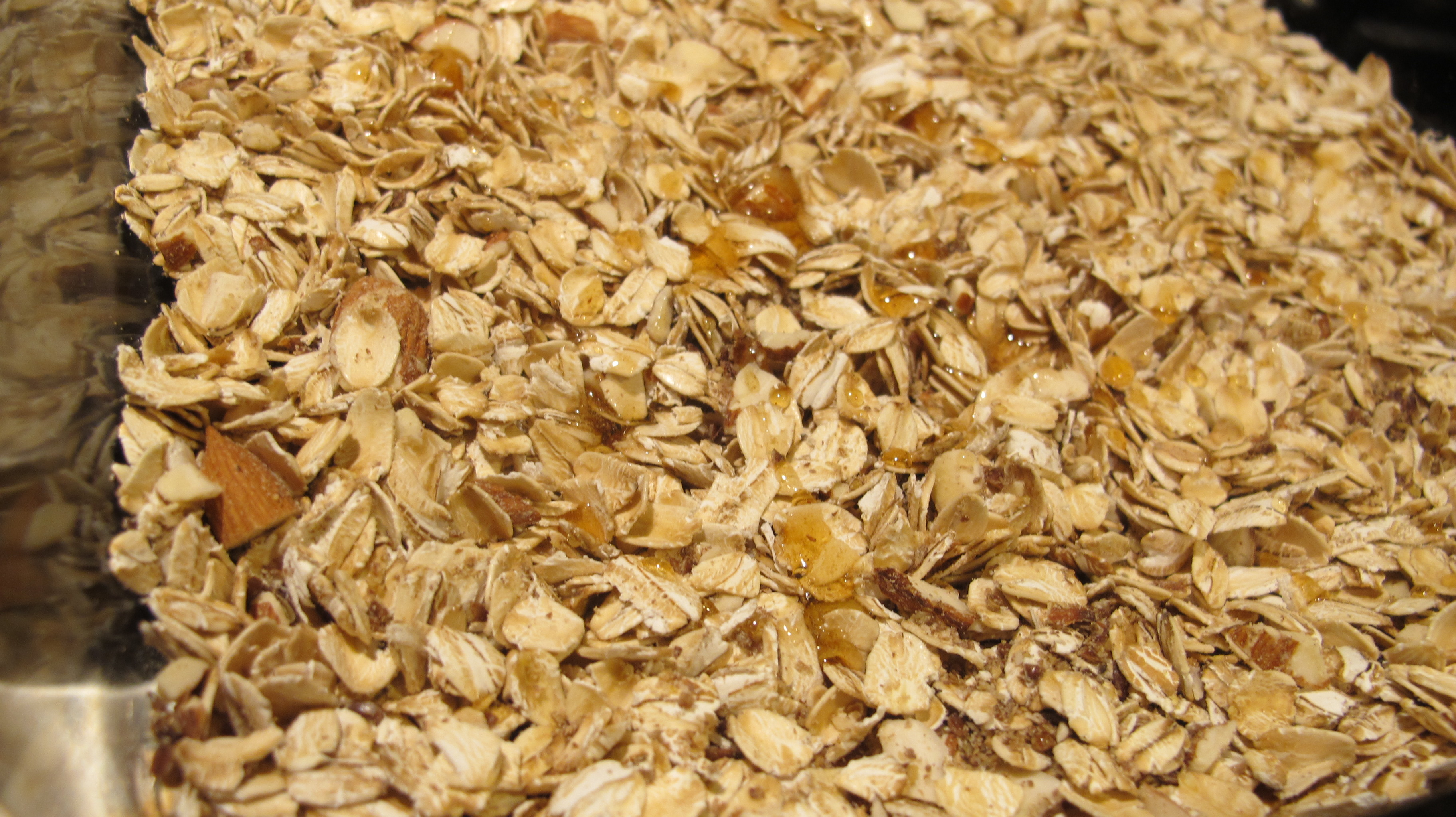 The honey mixture is drizzled over the muesli.