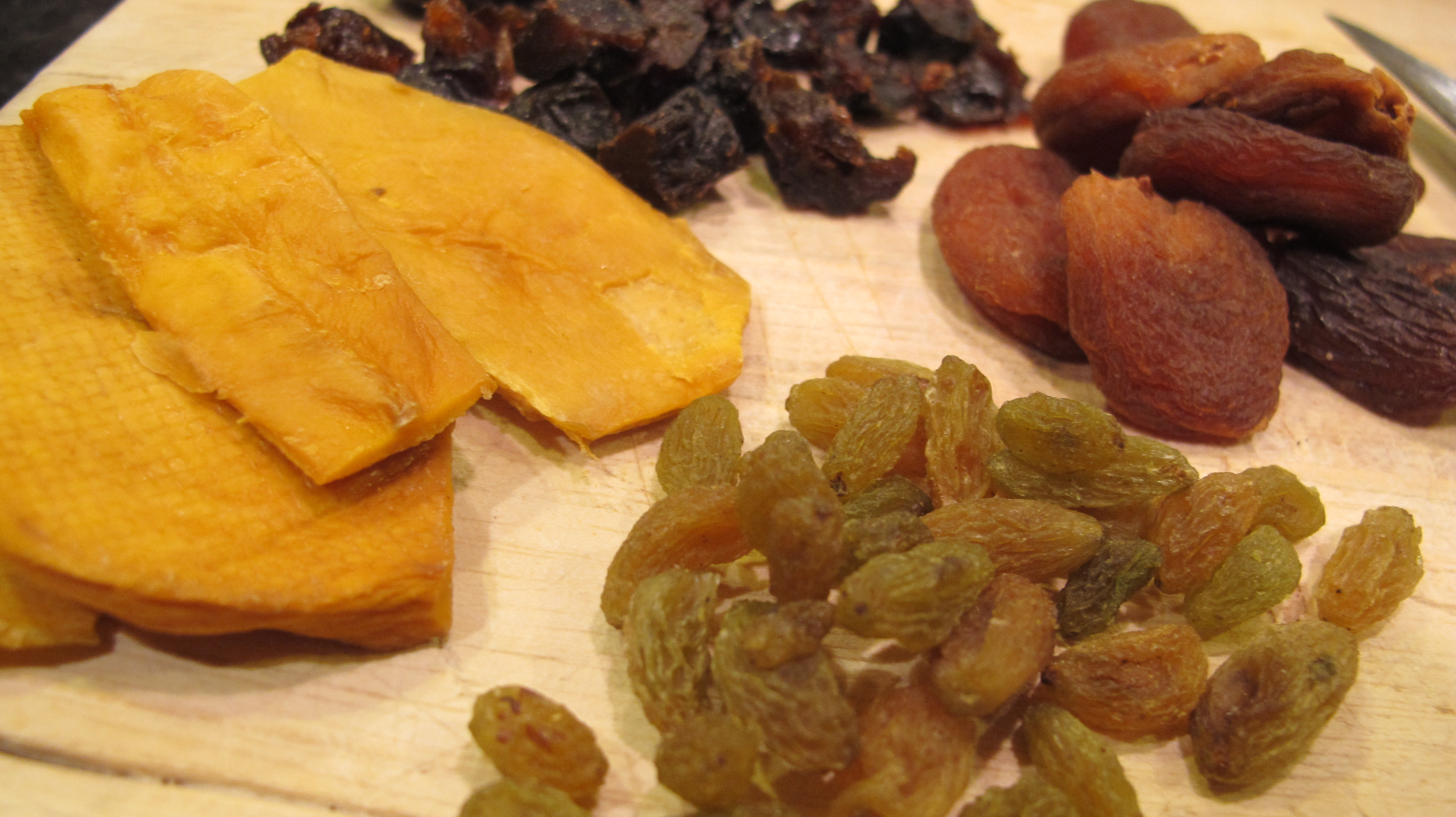 A fine selection of dried apricot, prune, mango, and raisins.
