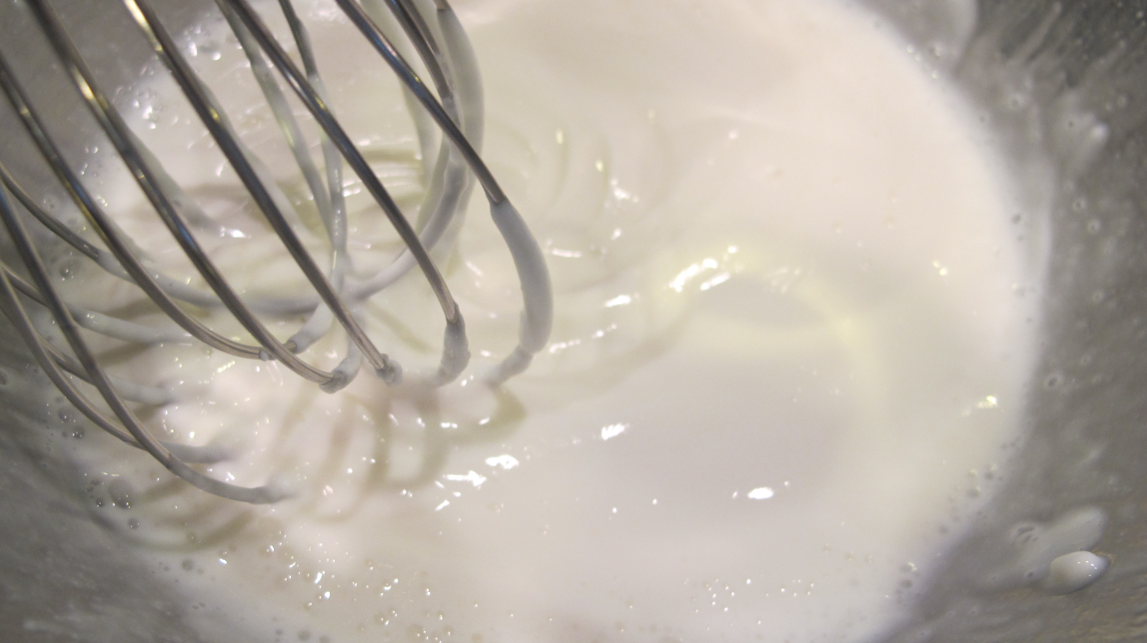 The thick yogurt is whisked with the milk.
