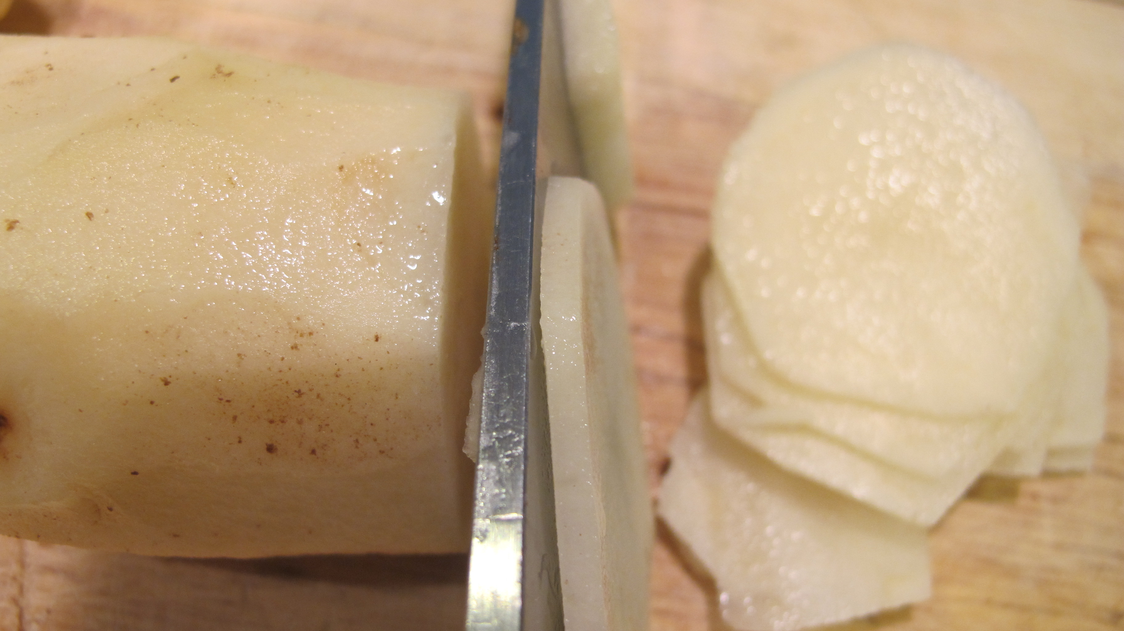 Thinly slice the potatoes with a knife or mandolin slicer.
