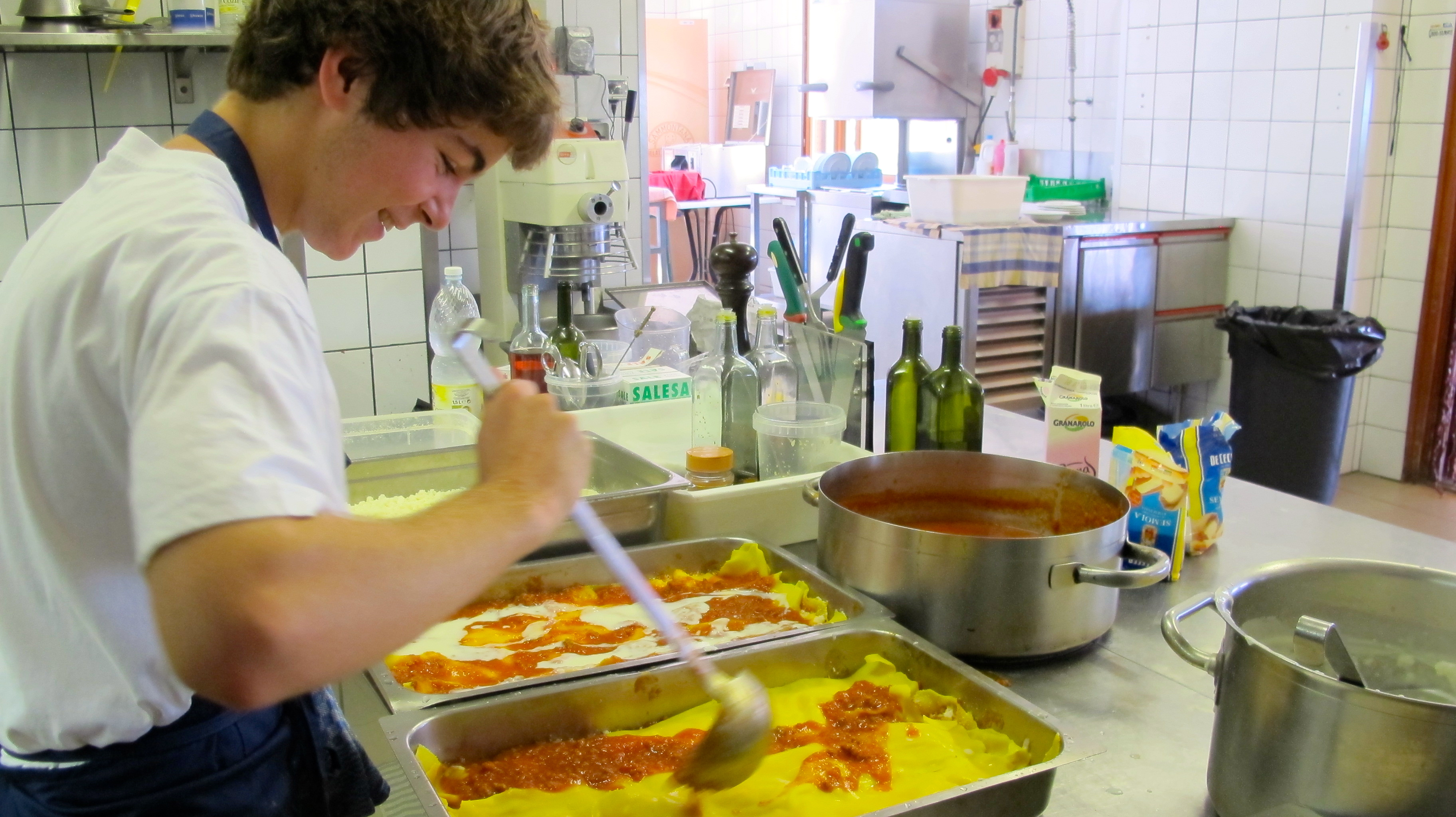 Preparing the homemade lasagna at the Agrihotel Elisabetta.