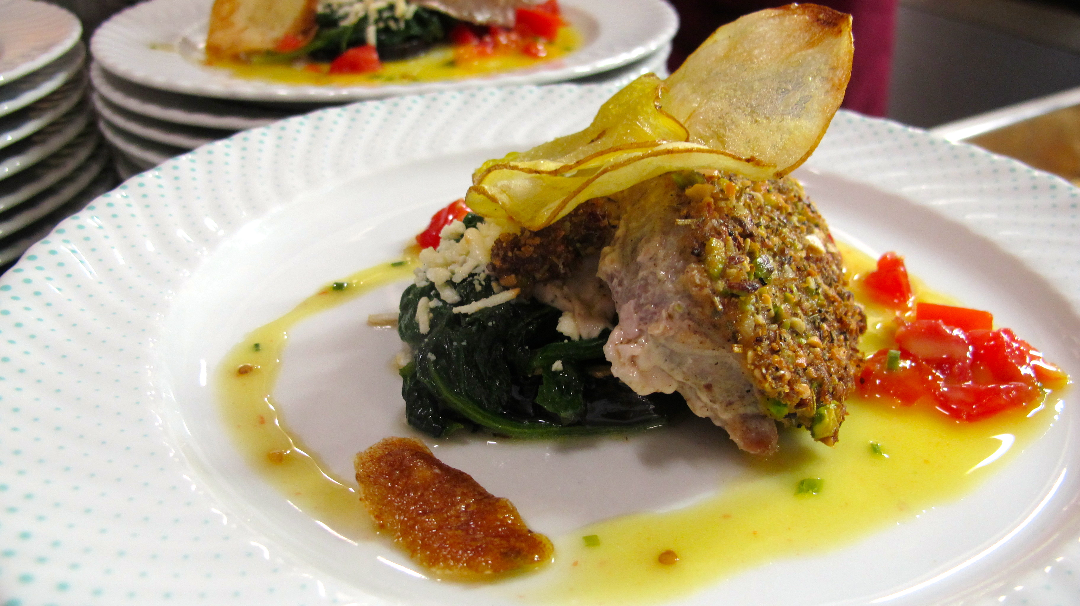 Tuna in a pistachio crust with spinach, tomatoes, and tropical sauce, and house-cut potato chips. I did the chips and diced the tomatoes, thank you very much.