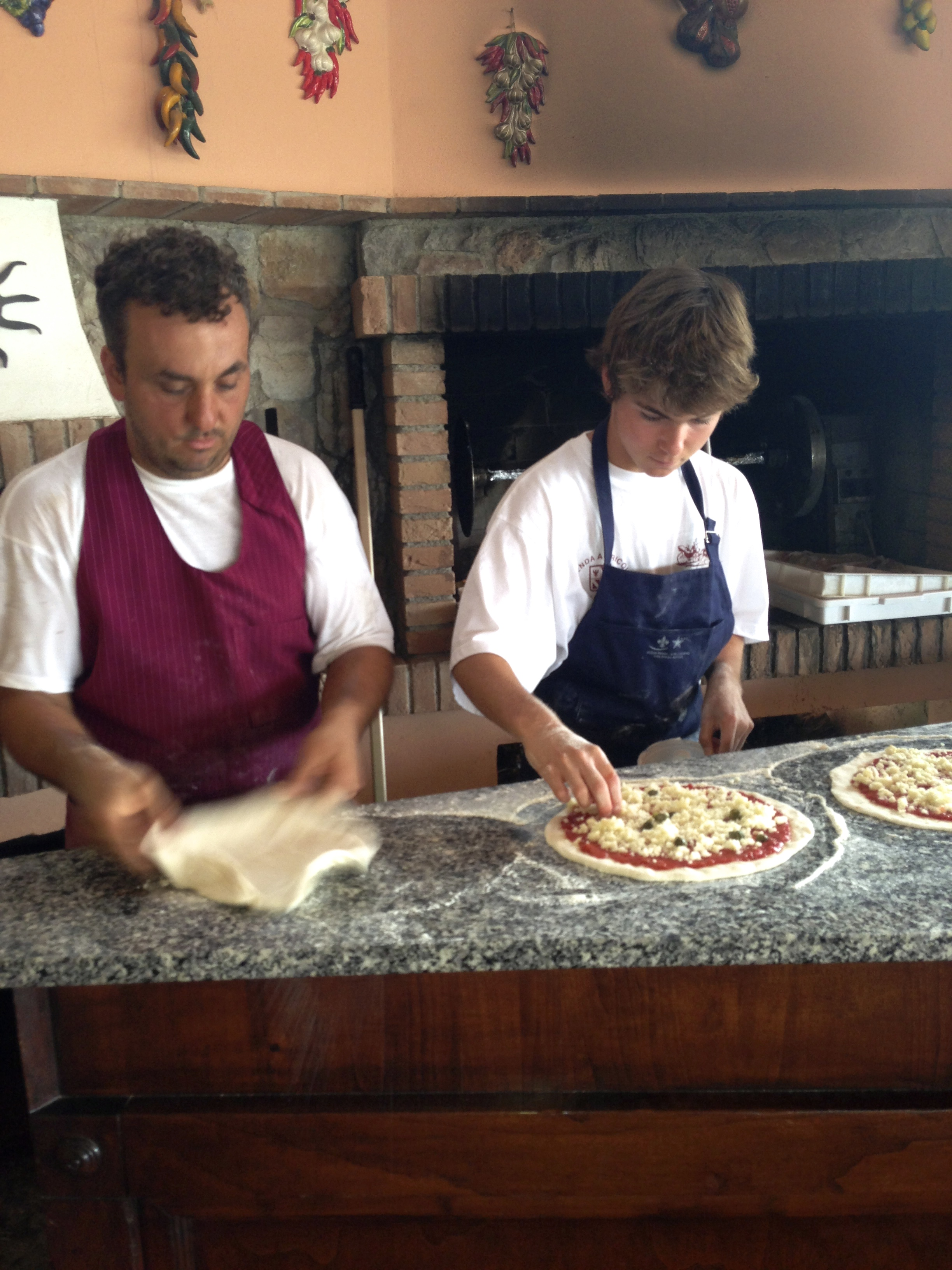 Learning from the master pizzaiolo, Head Chef Leonardo.
