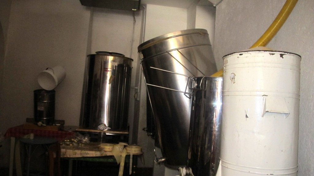 The honey is then piped into these tanks in a very small room.. a room not quite as nice looking.