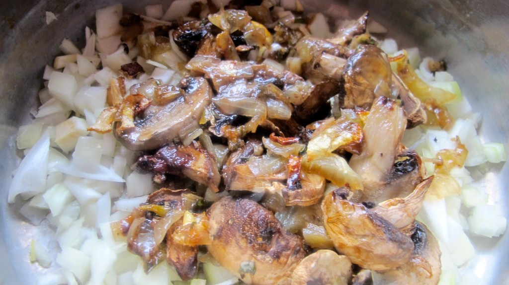 Add the cooked mushroom, onion, and beef juices to the uncooked onion in a medium saucepan.