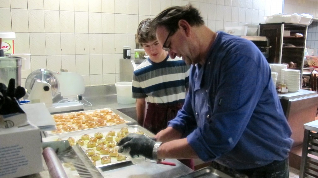 Tony shows me how to prep the pastries for proper presentation.