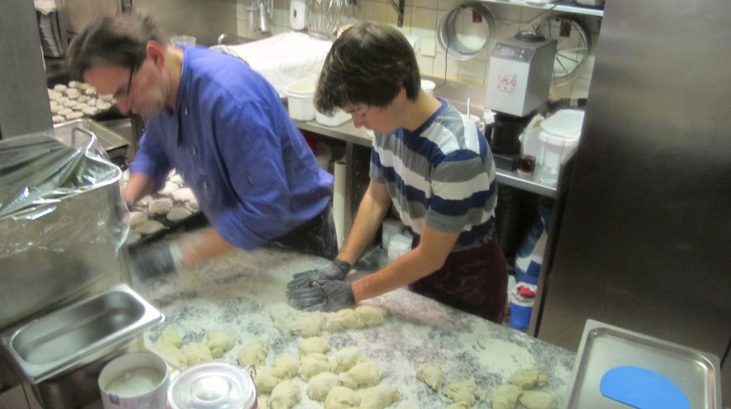 Tony shows me the ropes to crank out a nice rolled ball of dough.