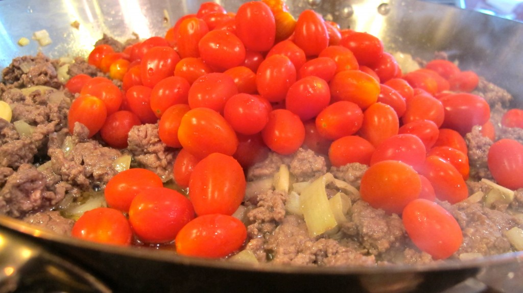 Add the cherry tomatoes (I did not slice them in half, and regretted it).