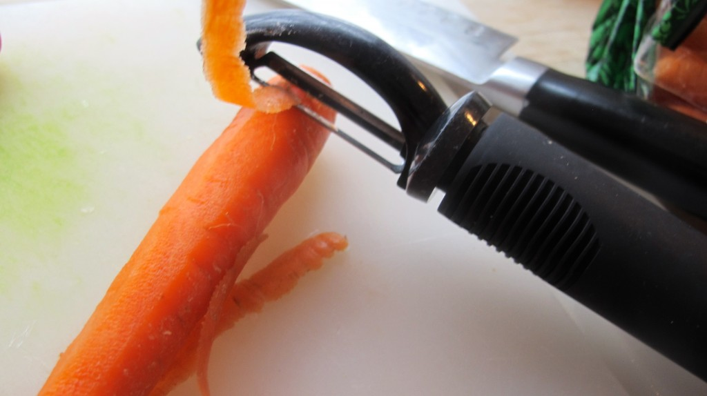 Peel the carrots before chopping.