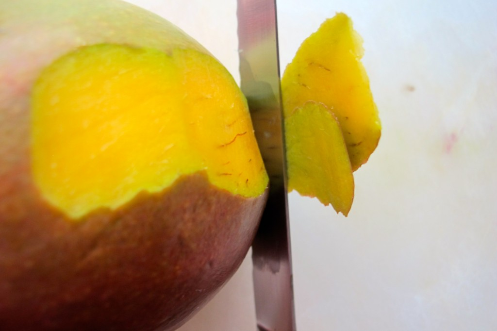 Peel the mango.