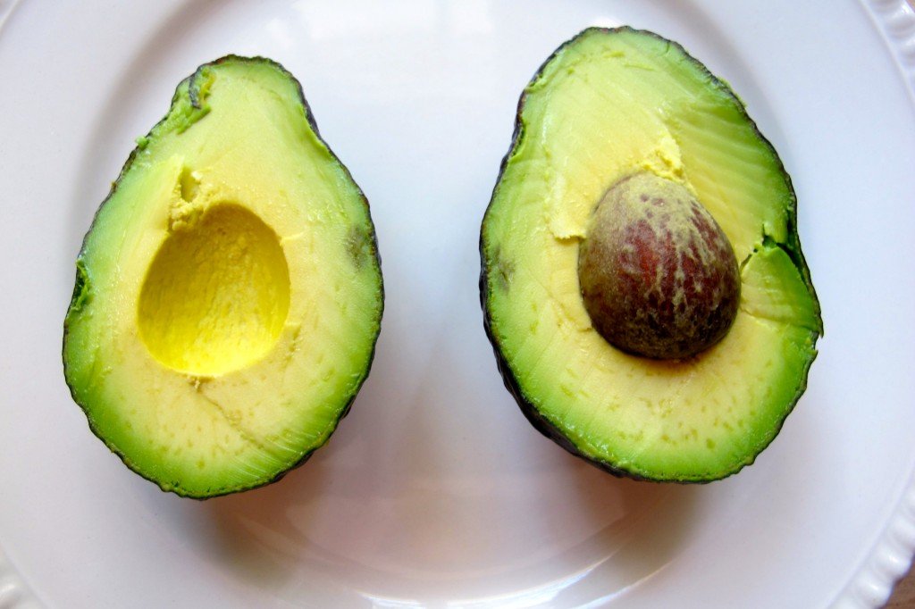 Cut the avocado in half. We will only use one half for two servings of salad.
