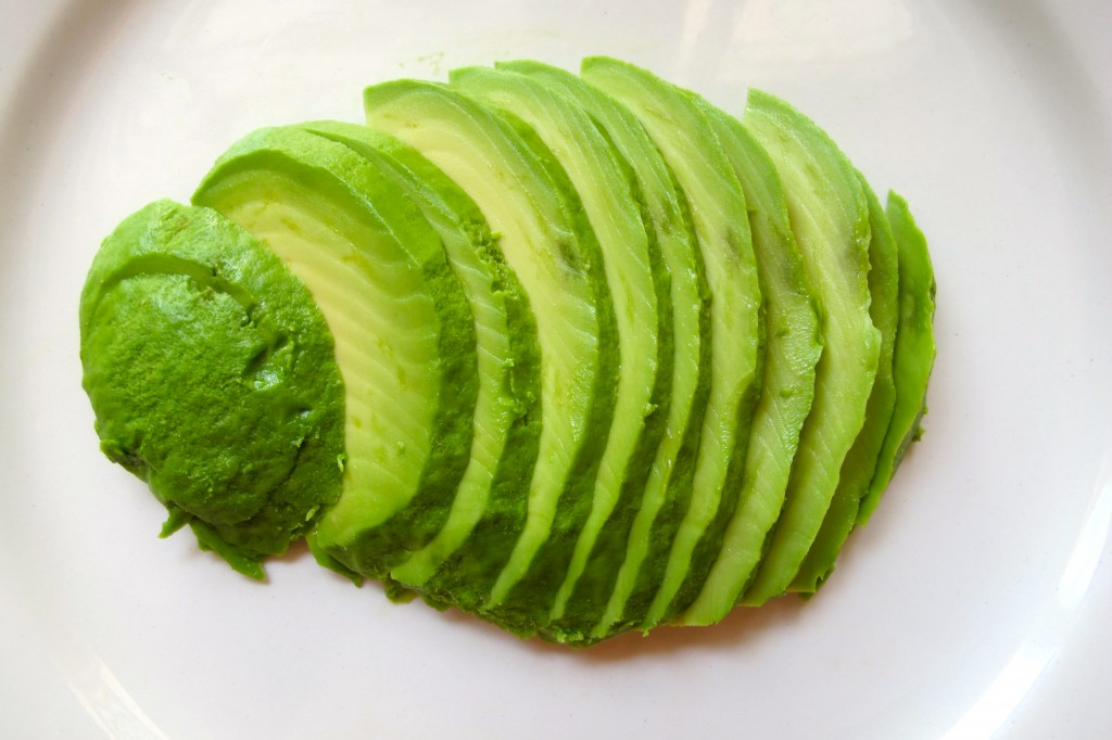 Thinly slice the avocado half.