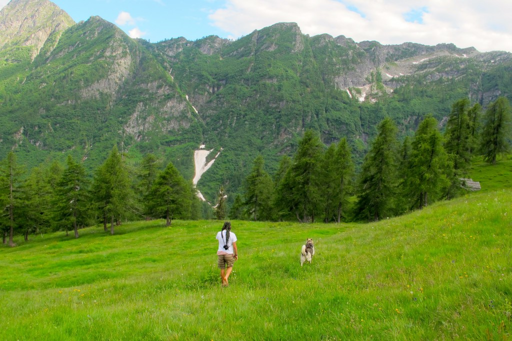 Francesco hiking barefoot with his dog, Chipa.