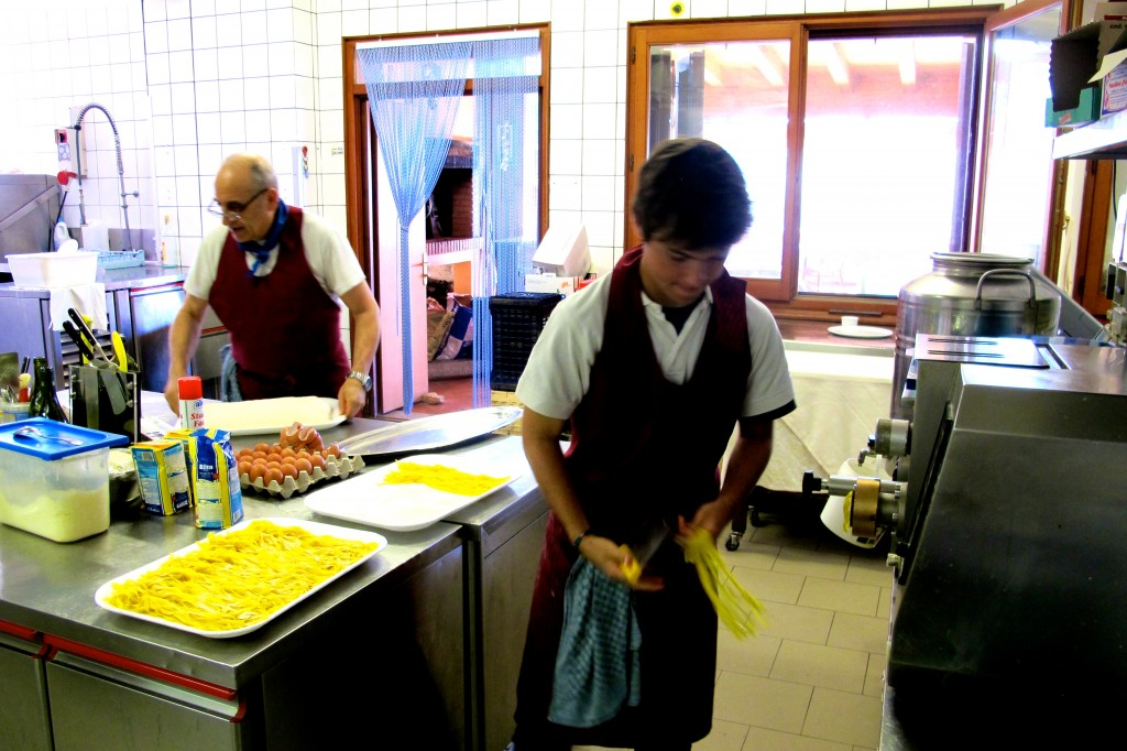 Making pasta at the Agrihotel. Doing this and making meatballs were two common tasks in the morning.