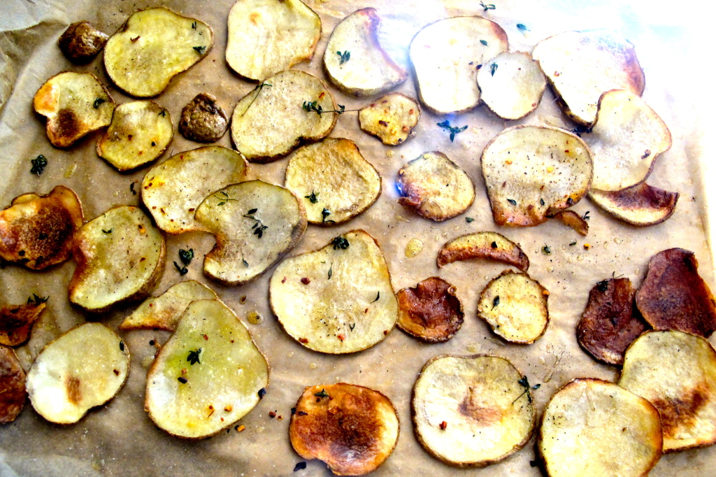 Roasted potato chips, hand sliced.