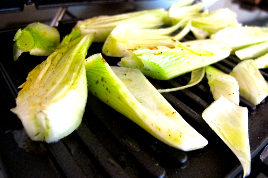 Grill the fennel, seasoned with salt, pepper, and olive oil.