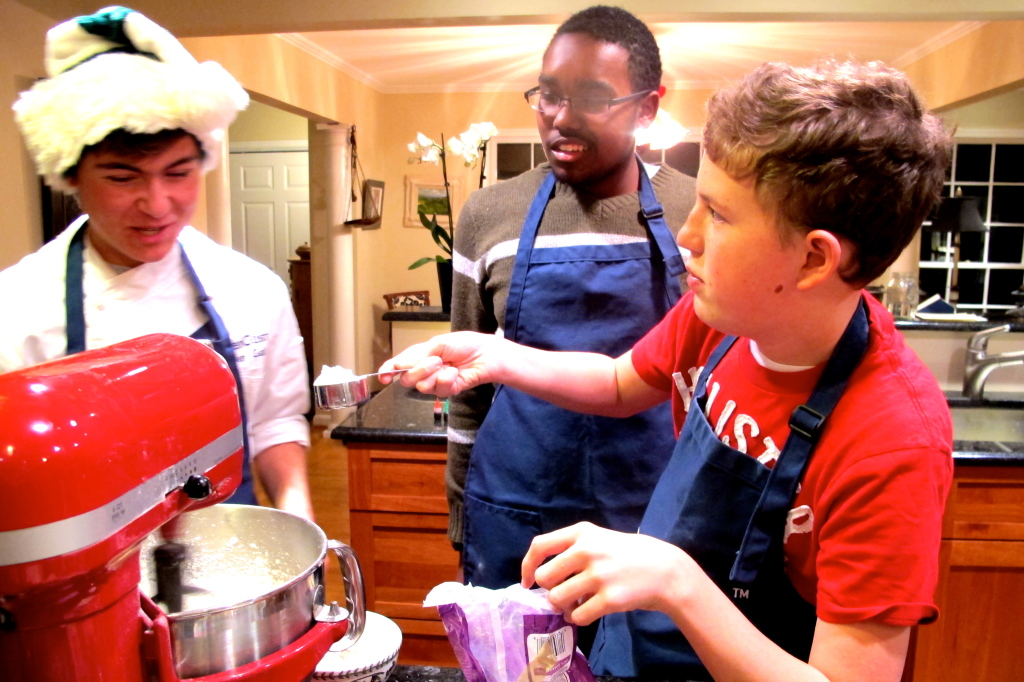 Patrick, CJ and I debate over the amount of powdered sugar we need for our cream cheese icing.
