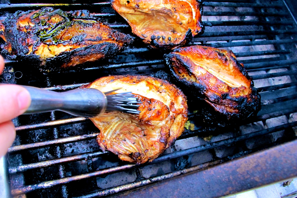 Rub olive oil seasoned with thyme and salt on top of each chicken a few times while grilling.