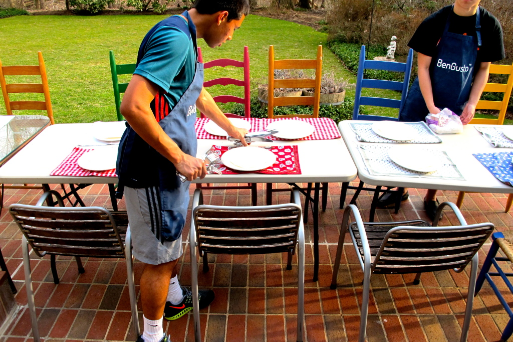 Andrew and Lorenzo set the table outside.