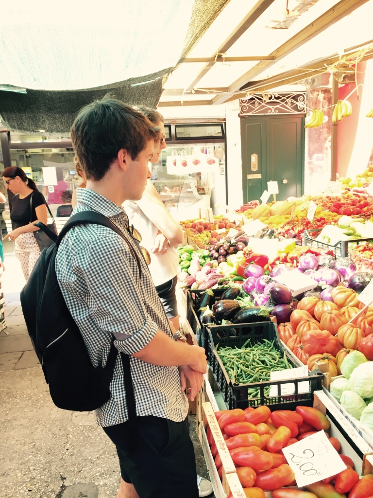 On the backpacking trip, at the famous Rialto market in Venice.